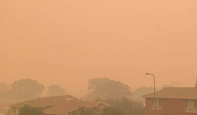 Orange bushfire smoke haze